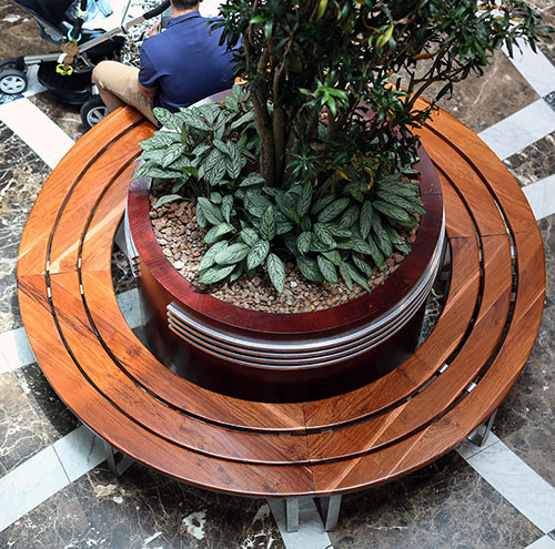 Bespoke round timber slat benches