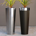 Round steel and stainless steel range of planters