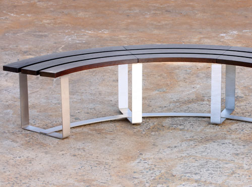 Curved timber and stainless steel bench