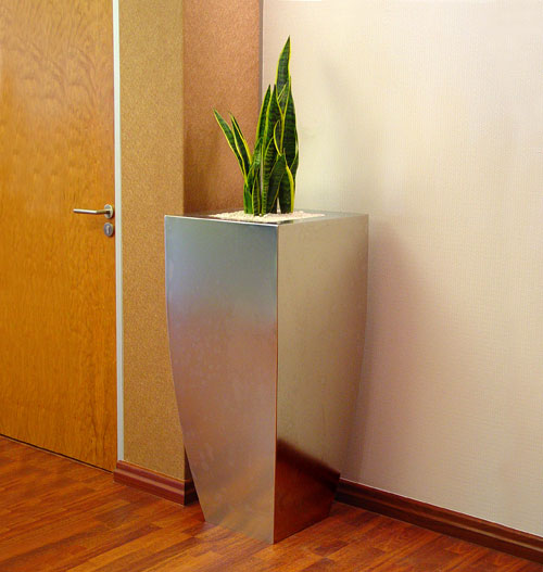 Stainless steel planter in corporate office.